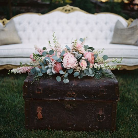 Chest and floral decor