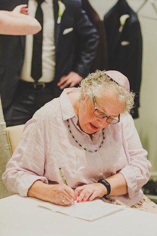 Rabbi Gail signing Ketubah