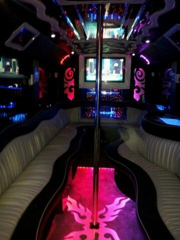 An interior picture featuring dance floor which changes colors to the beat of the music and a dance...