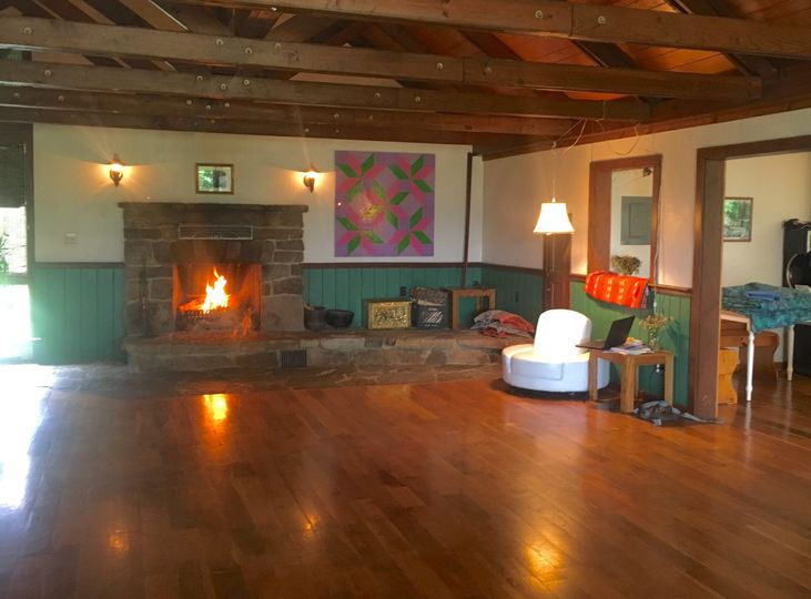 A cheerful fire takes the chill off of a cool night. The great room is a good place to dance, hear...