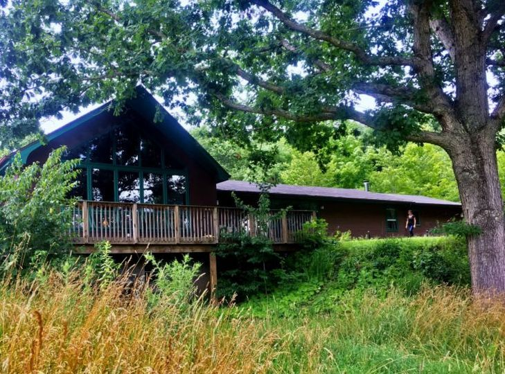 Our lodge has a large deck, a covered porch, and large lawns for outdoor events—all with stunning...