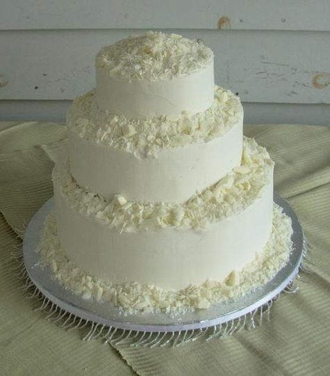 White Chocolate Shavings surround this simple white cake for a winter wedding.