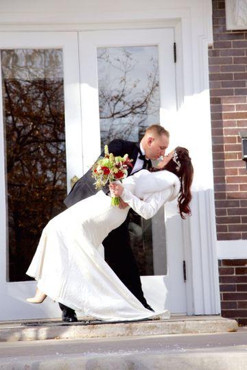 A romantic newlywed kiss