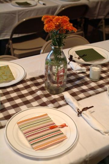 To complete the country theme, we used brown check gingham for table runners and decorated with a...