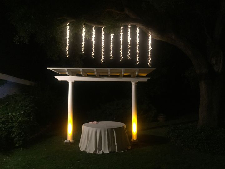 Our cluster lighting and LED Up-Lighting illuminating the cake table at Grace Vineyards in Galt, Ca.