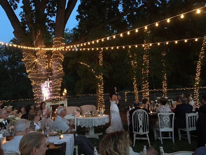 Our market lights, LED Up-Lighting and custom tree wrap for a backyard wedding reception in Ione,...