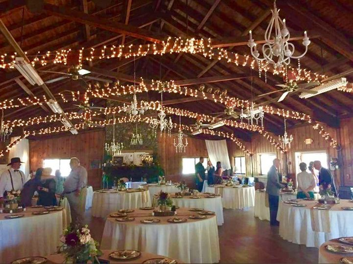 Chandeliers and mini lights for a barn wedding at Camp Pollock in Sacramento, Ca.