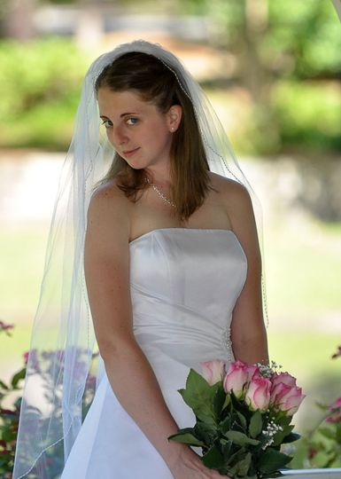 Bride looking directly at camera in Greenfield Lake, NC. Billy Beach.