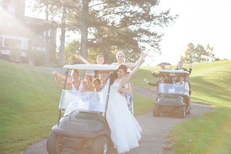 Bride and bridesmaids riding a golf car