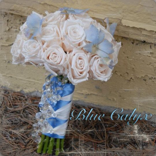 This bouquet doubles as a keepsake.  It is made from real PRESERVED flowers.  These flowers keep...