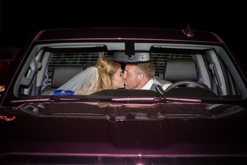 Couple kissing inside the car
