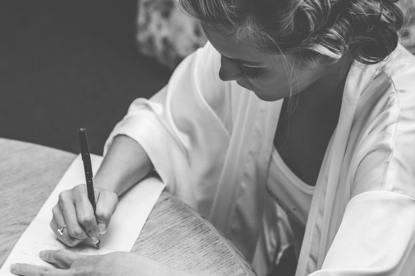 The bride writing