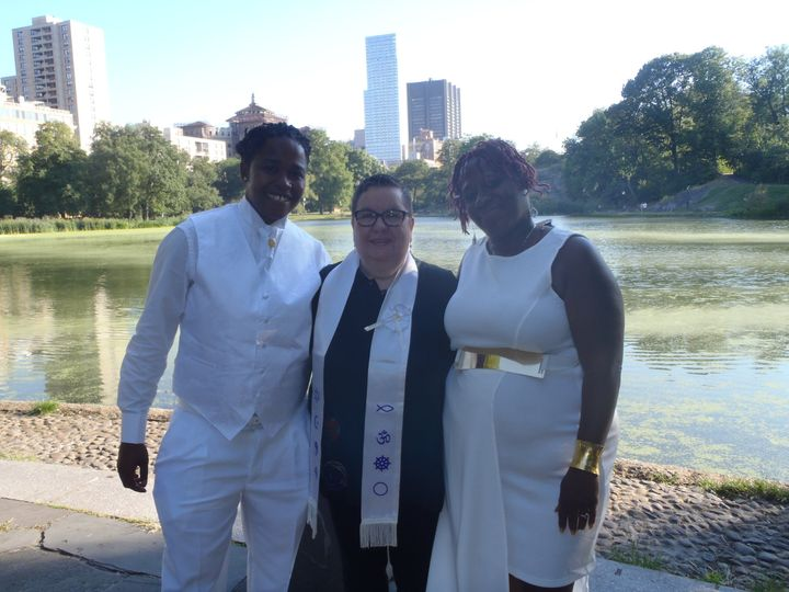 Divine summer wedding at Central Park Harlem Meer with lake in background. Space blessing with...
