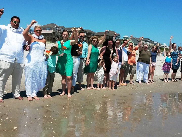 Tmx 1464797168312 Everyone Line Up Holding Their Shells Raleigh, North Carolina wedding officiant