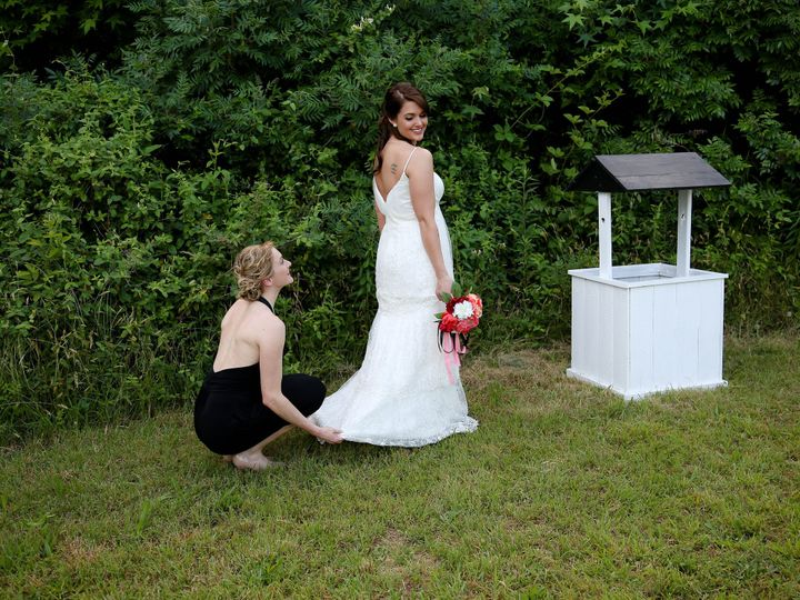 Tmx 1468366601763 Bridemaid Fixing Brides Dress With Wishing Well Raleigh, North Carolina wedding officiant