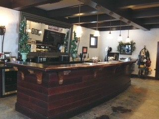 This is our large bar located inside the tasting room. It is cleared off so that guests can lounge...