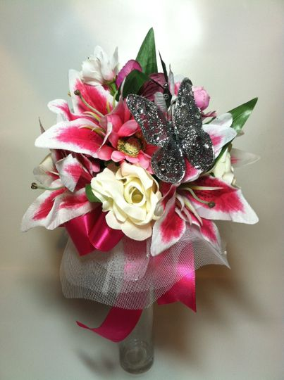 This is a Bridesmaid Bouquet for a bride who had pre-purchased flowers and we added some items to...
