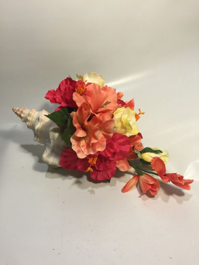 This conch shell centerpiece was for a destination wedding and was packaged carefully for the...