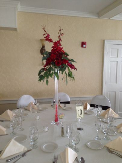 This centerpiece features fresh flowers with an eiffel tower vase that I was able to rent out so she...