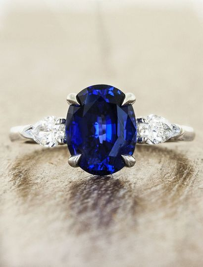 Permelia Sapphire: a three stone oval sapphire engagement ring with pear shaped side diamonds.