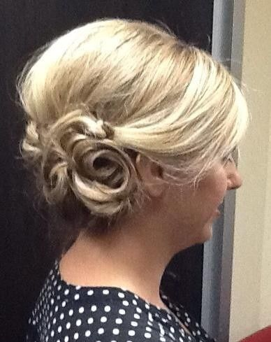 Swept to the right side updo.