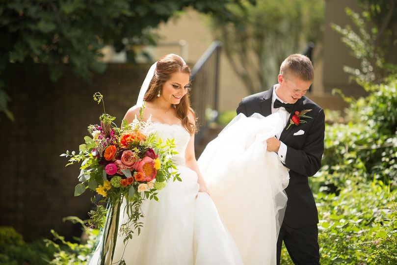 Newlyweds beginning their story by navigation of the stairs in the church grounds