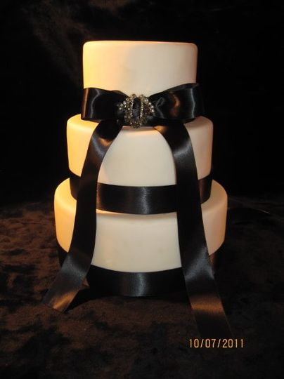 Creative Cakes by Kim..... Fondant 3 Tier with bow