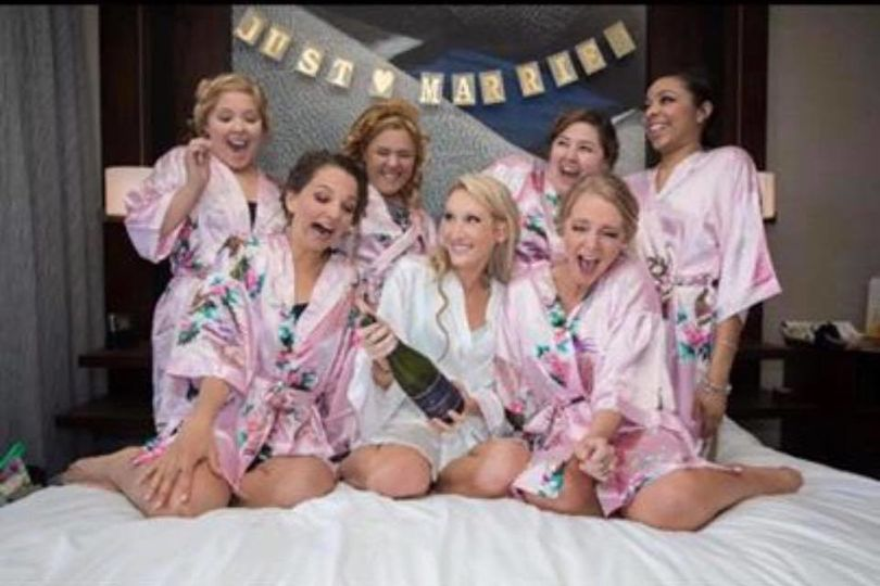 Bride having fun with the bridesmaids