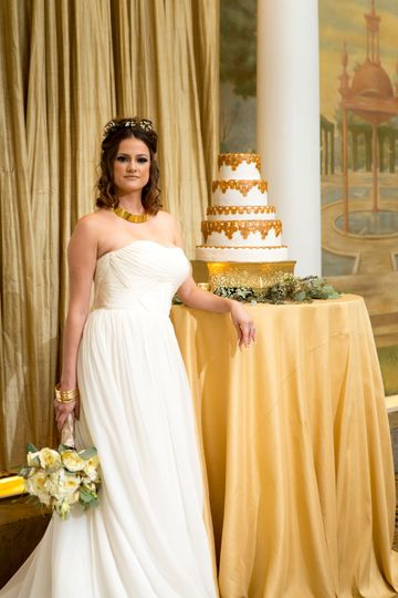 Bride by the wedding cake