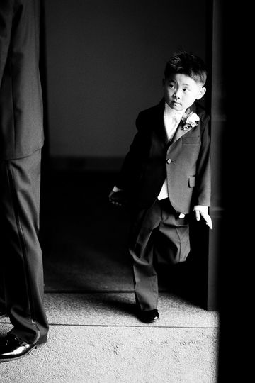 Ringbearer watches the groom walk past