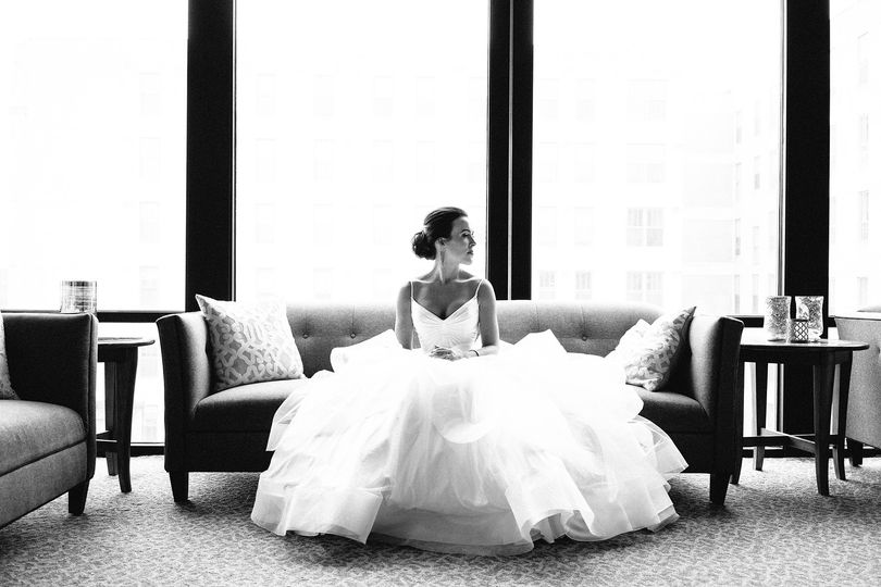 Bride sitting at A'Bulae in St. Paul, MN before the ceremony
