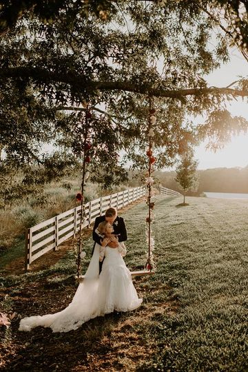 Newlyweds by the swing