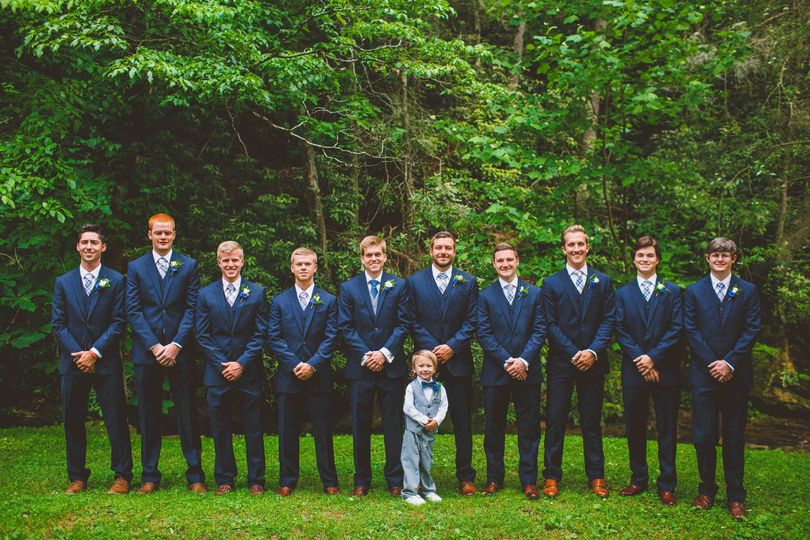 The groom with his groomsmen and page boy