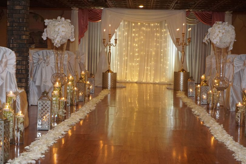 Candlelit aisle and floral decor