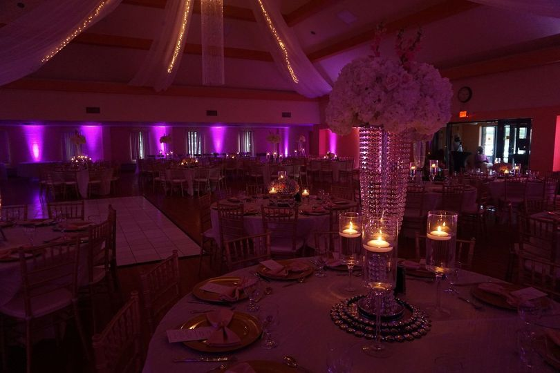 Raised floral centerpiece and candle lights