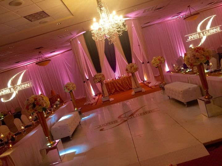 Gorgeous monogram dance floor and lighting in addition to custom drape by Central Arkansas...