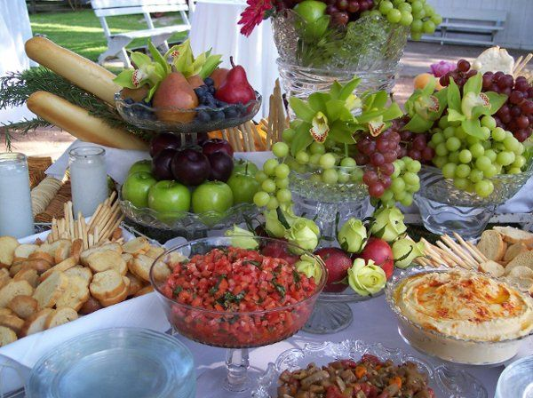 Creative presentation of Bruschetta Toppings and Cheese & Fruit Display.