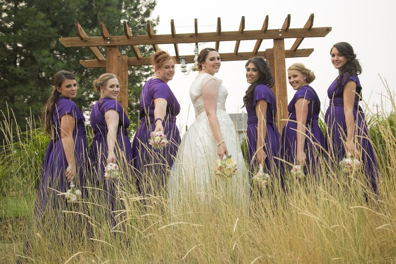 Bridesmaids in purple and their bride