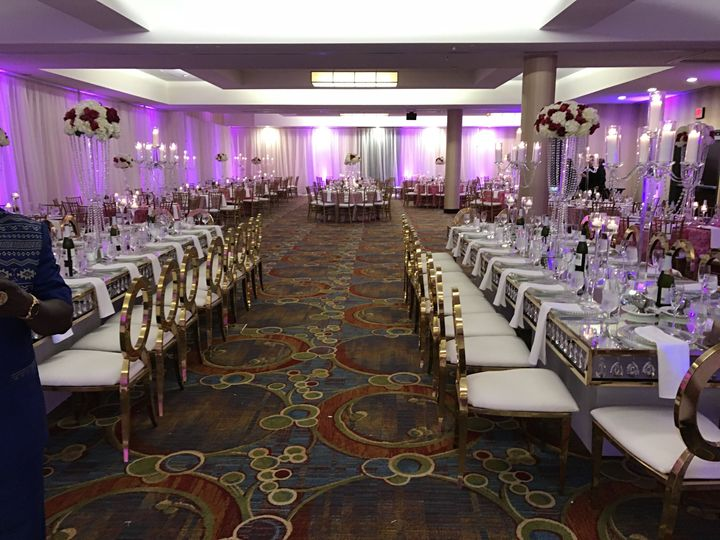 Custom specialty gold chairs and crystal tables brings a new level of elegance to