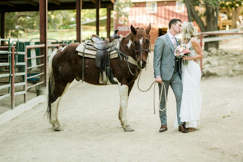 happy couple with one of the ranch horses at the Circle Bar B Stables