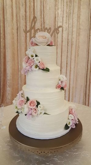 White cake with pink and white flower decor