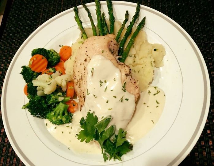 Herb Chicken with Rosemary Lemon sauce over garlic mashed potatoes and steamed asparagus spears.