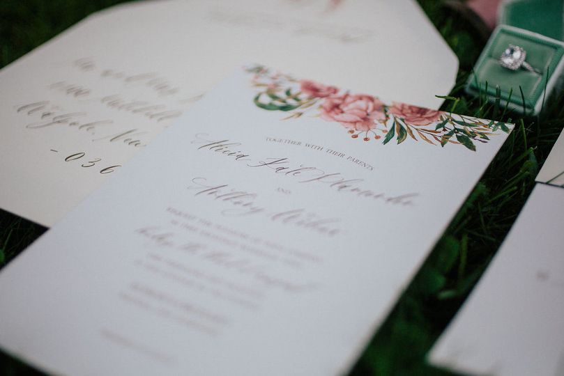 Invitation with flower design on top