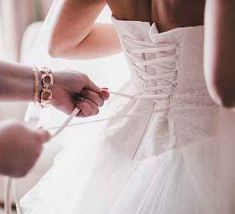 Bride being dressed