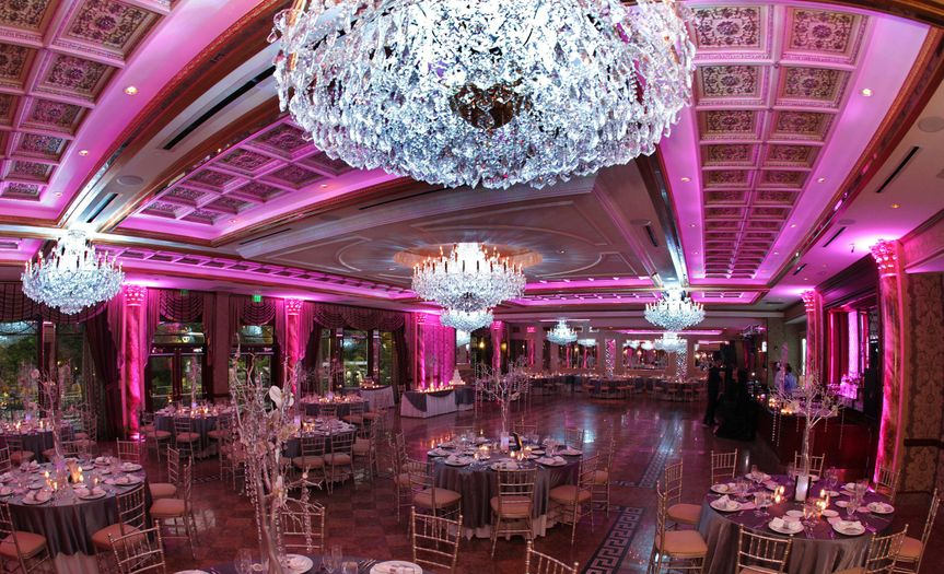Opulent chandeliers and pink uplighting
