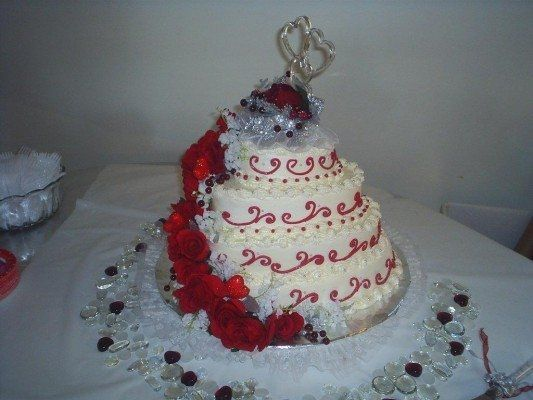 Heart tiers, buttercream icing, silk roses.