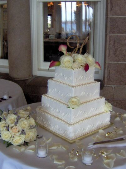 All white square wedding cake