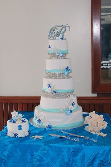 Tall wedding cake with blue ribbons