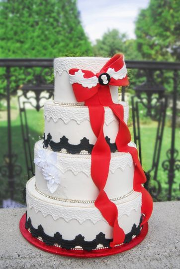 Tall wedding cake with red bow
