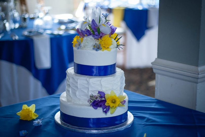 Wedding cake with blue ribbons